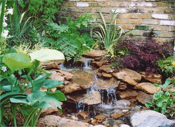 Fountains water features for Small pond water feature
